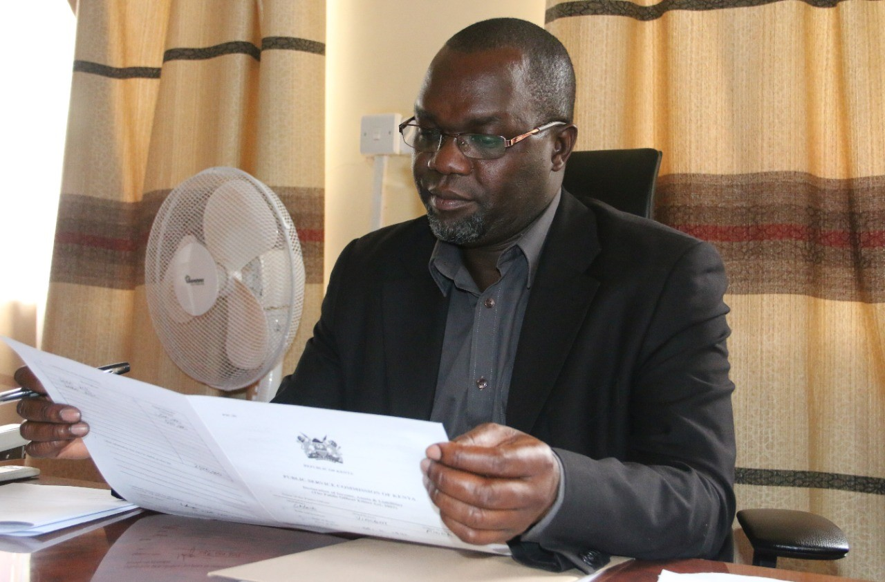 Kisii County Minister for Roads and Public Works Vincent Sagwe in his office