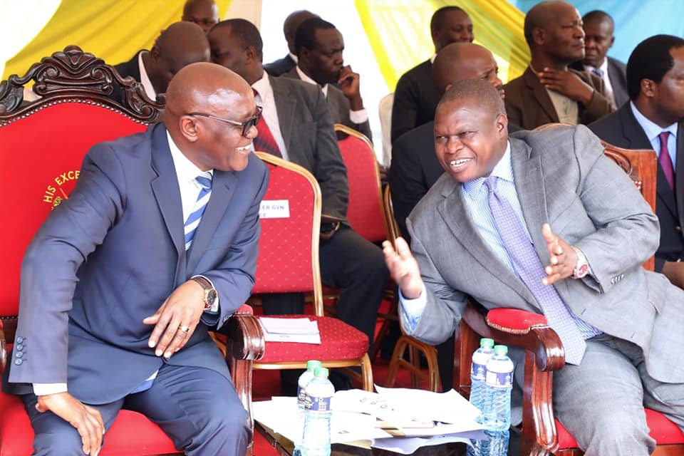 Right is Kisii Deputy Governor Joash Maangi cracking a Joke with Kisii Governor James Ongwae on Wednesday during the swearing in of Public Service Board Members Photo/Rogers Gichana
