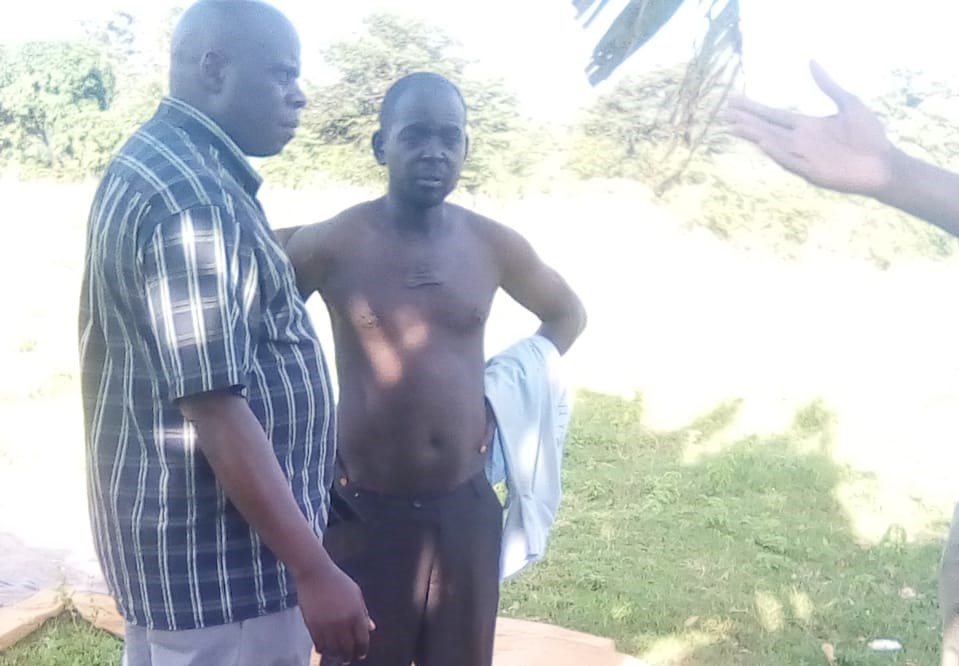 Without a shirt is Patrick Onyango the 45 year old who exhumed his wife's body Photo/Courtesy.