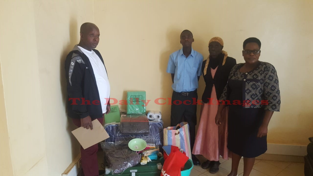 From Left is Sensi ward MCA Paul Angwenyi, Baraka Melchzedek and Rachel Mogere the Mother Photo/Daily Clock