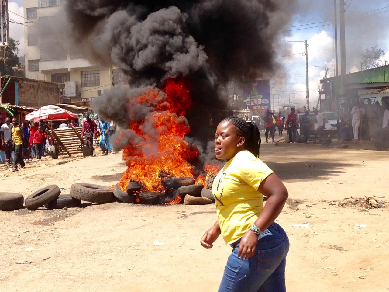 A protester crossing over the Road in Kawangware on Monday Photo/Courtesy