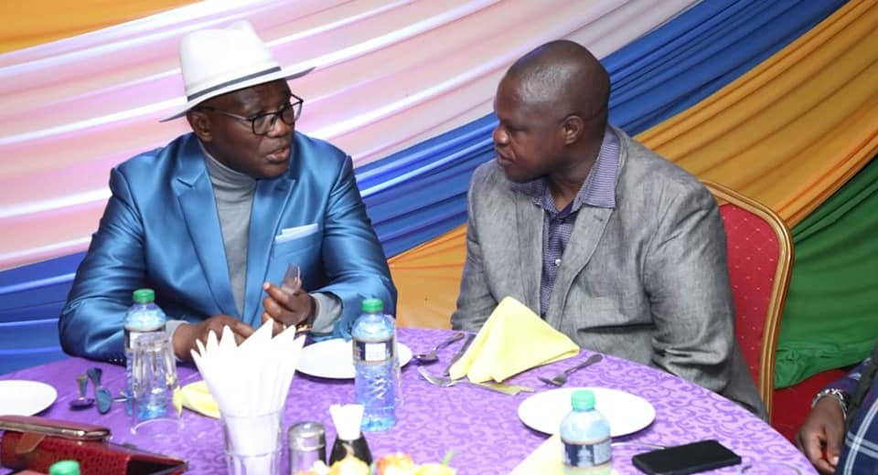 Right is Kisii Deputy Governor Joash Maangi conversing with Kisii Governor James Ongwae at Kisii school during the end year cross over ceremony Photo/Daily Clock