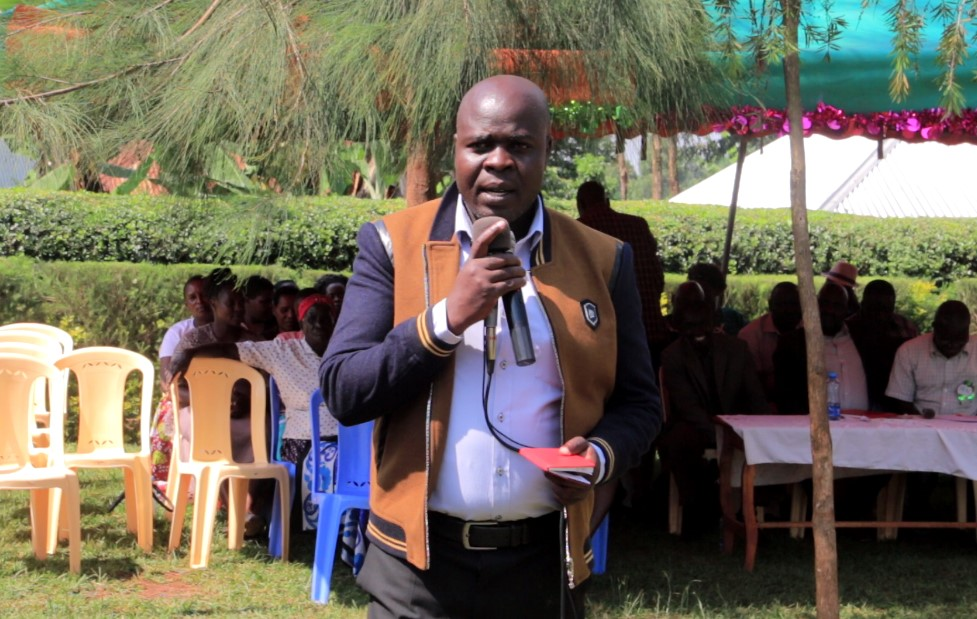 Rapson Sagana Director Heartlight Friends Academy in Ogembo addressing parents during a prize giving Ceremony Photo/Rogers