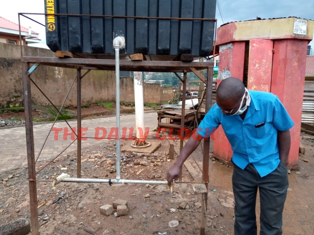 A matatu Operator opening a tap in one of the hand wash water points at Main bus stage in Kisii Town Photo/Rogers Gichana