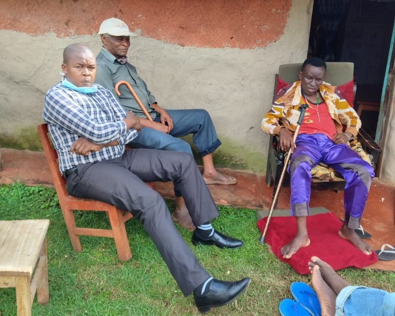 Abraham Osero with James Ragira when he visited him at his rural home Photo/Abraham