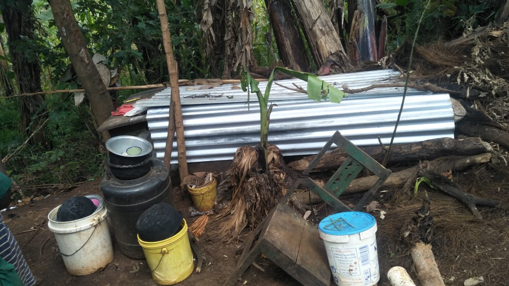 Okengo Nyambane Foundation building a house for the homeless family which has been living under the table inside a banana plantation.