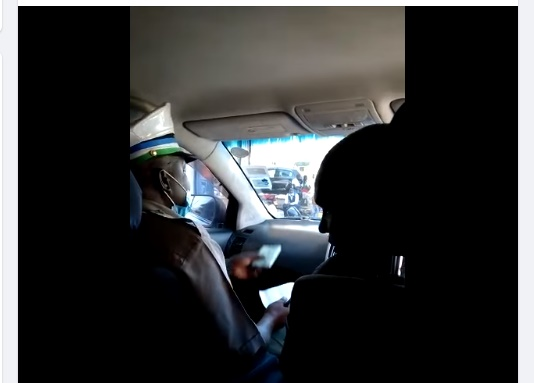 Kisii County Government enforcement Officer allegedly caught on Camera soliciting for a bribe from a car owner seeking for a parking lot.