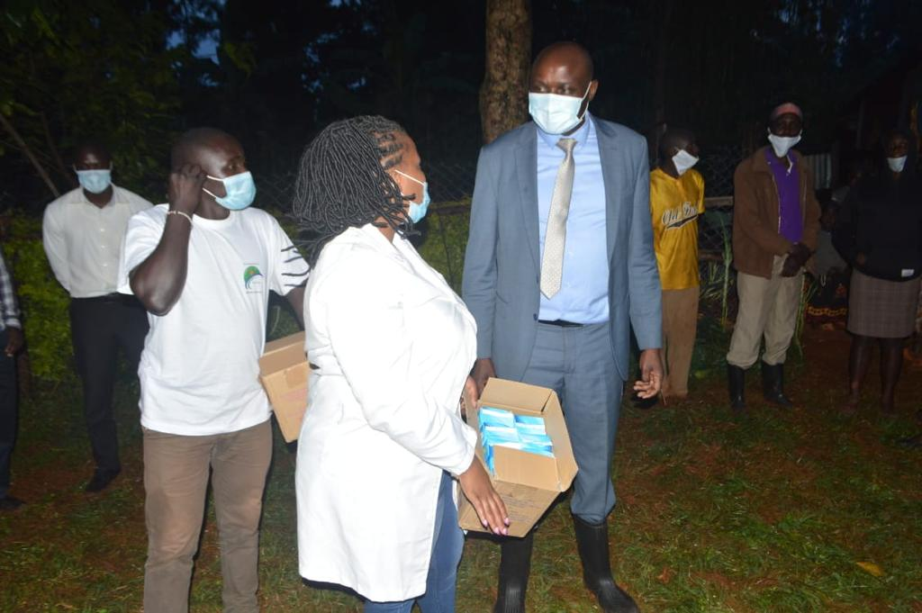 Dr. Water Okibo with Care and Cure Hospital donating Sanitary Pads to Girls and Women in Marani Subcounty on August 2020 Photo/Rogers