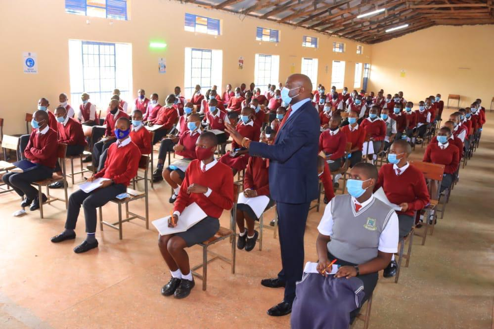 Dr. Walter Okibo talking to Students at St. Patrick Mosocho Mixed Secondary School in January 2021. Photo/Rogers